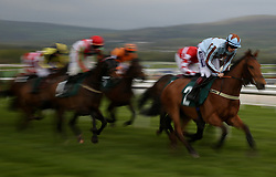 Jockey Sam Twiston-Davies (centre) ridding his horse Duke Street in the Kingston Stud Supporting The IJF Handicap Hurdle 4.20pm race during the April Meeting at Cheltenham Racecourse