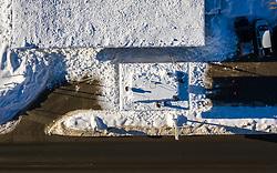 THEMENBILD - Arbeiter befreien das Dach einer Tankstelle von den Schneemassen in Matrei in Osttirol, Österreich am Dienstag, 5. Januar 2021. Luftbild, aufgenommen mit einer Drohne, nach den starken Schneefällen welche vom 5. bis 8. Dezember 2020 sowie vom 1. bis 3 Jänner 2021 über Osttirol und Oberkärnten nieder gingen, sorgten für grosse Neuschneemengen in der Region // Workers free the roof of a gas station from the masses of snow in Matrei in East Tyrol, Austria on Tuesday, January 5, 2021. Aerial photo, taken with a drone, after the heavy snowfalls which fell over East Tyrol and Upper Carinthia from December 5 to 8, 2020, and from January 1 to 3, 2021, caused large amounts of new snow in the region. EXPA Pictures © 2021, PhotoCredit: EXPA/ Johann Groder