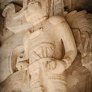 "Carved stone statue on the exterior of the Tomb of Ukit Kan Le'k Tok' on top of the Acropolis on the northern side of the Ek'Balam archeological site on Mexico's Yucatan Peninsula. It was once a thriving city of Maya Civilization dating to the Late Classic period. It is 30km north of Valladolid and is named for ""Black Jaguar"" a distinctive motif throughout the site."