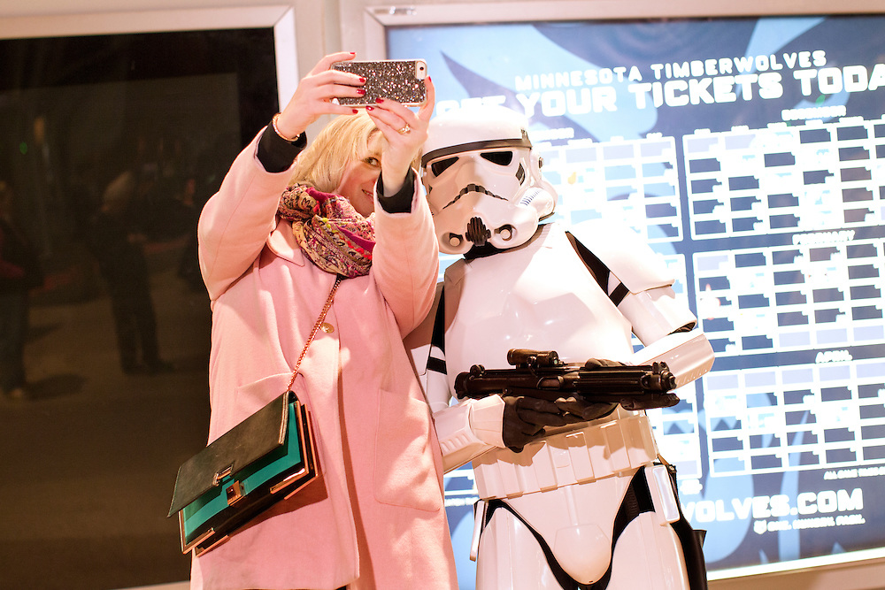 Christine Hoehne, left, of Minneapolis, takes a selfie with a Storm Trooper as the 501st Legion Central Garrison mingles with fans at Star Wars night at the Timberwolves game at Target Center in Minneapolis December 15, 2015.