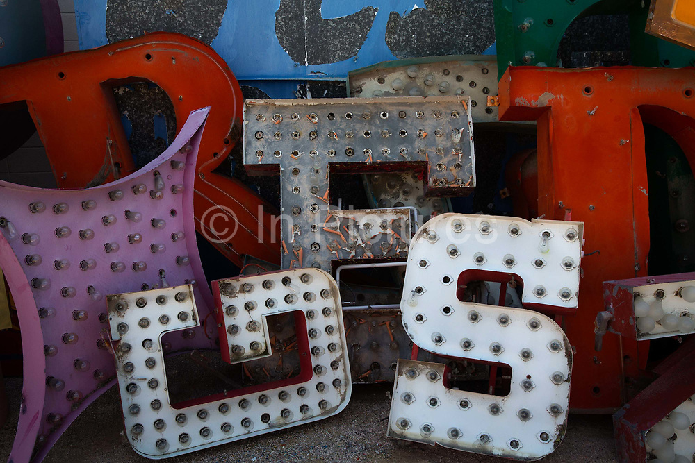 """Lettering from the Neon Boneyard in Las Vegas. The Boneyard features more than 150 signs. For many years, the Young Electric Sign Company stored many of these old signs in their """"boneyard."""" The signs were slowly being destroyed by exposure to the elements."""