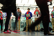 De La Salle Institute student Alex Estrada (with violin) leads a group of 12 Algebra classmates and Christmas carolers including (to right) Andrew Bahena and Grant Lopinski at Millenium Station on Wednesday, December 12th, 2012. The annual event is hosted by the Big Shoulders Fund, an independent charity benefiting 95 of Chicago's Catholic schools, including De La Salle. l Brian J. Morowczynski~ViaPhotos..For use in a single edition of Catholic New World Publications, Archdiocese of Chicago. Further use and/or distribution may be negotiated separately. ..Contact ViaPhotos at 708-602-0449 or email brian@viaphotos.com.   .Students from Mark Jackowiak's Alegebra 2 class at De La Salle Institute perform Christmas carols for weekday commuters at Millenium Station Wednesday, December 12th, 2012. The annual event is hosted by the Big Shoulders Fund, an independent charity benefiting 95 of Chicago's Catholic schools, including De La Salle. l Brian J. Morowczynski~ViaPhotos..For use in a single edition of Catholic New World Publications, Archdiocese of Chicago. Further use and/or distribution may be negotiated separately. ..Contact ViaPhotos at 708-602-0449 or email brian@viaphotos.com.