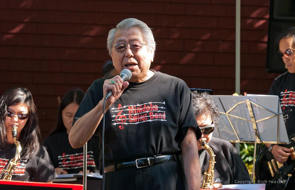 "Vocalist Henry ""Shig"" Sakamoto performs with the Minidoka Swing Band on the grounds of Washington Country Museum, Hillsboro, Oregon"