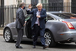 © Licensed to London News Pictures. 26/11/2020. London, UK. BritishPrime Minister Boris Johnson removes his face mask returning to Downing Street after attending Parliament for the first time since Covid 19 self-isolation. Photo credit: London News Pictures