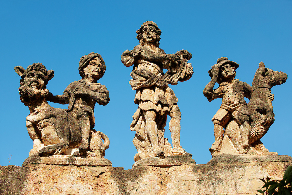 """Baroque character study statues from the walls of Villa Palagonia Bagheria Sicily. The statues of monsters with human faces that decorate its garden and its wall, and earned it the nickname of """"The Villa of Monsters"""" (Villa dei Mostri). This series of grotesques, created from 1749 by Francesco Ferdinando II Gravina, Prince of Palagonia, aroused the curiosity of the travellers of the Grand Tour during the 18th and 19th centuries<br /> <br /> USEFUL LINKS:<br /> Wikipedia https://en.wikipedia.org/wiki/Villa_Palagonia .<br /> <br /> Visit our SICILY PHOTO COLLECTIONS for more   photos  to download or buy as prints https://funkystock.photoshelter.com/gallery-collection/2b-Pictures-Images-of-Sicily-Photos-of-Sicilian-Historic-Landmark-Sites/C0000qAkj8TXCzro<br /> If you prefer to buy from our ALAMY PHOTO LIBRARY  Collection visit : https://www.alamy.com/portfolio/paul-williams-funkystock/villapalagonia.html"""