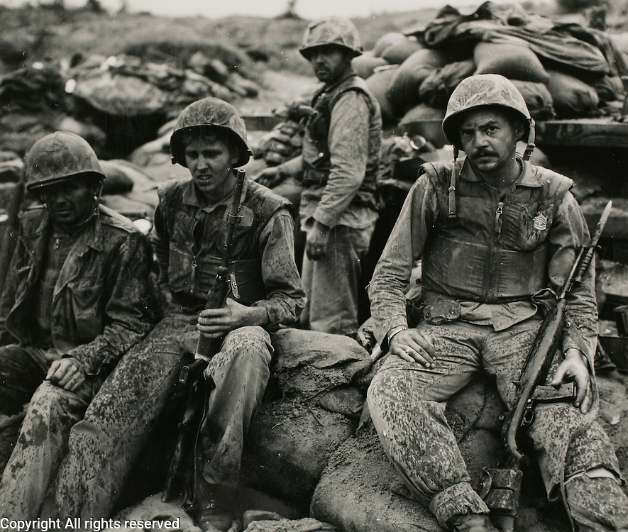 """1st MarDiv Chang-Dan Korea Aug 26, 1952 Photog: SSgt. Scullin..Marines with """"F"""" Company, First Marine Regiment take a break during a lull in the fighting on Bunker Hill."""