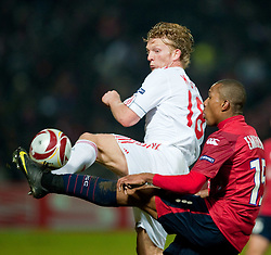 LILLE, FRANCE - Thursday, March 11, 2010: Liverpool's Dirk Kuyt and LOSC Lille Metropole's Emerson, EXPA Pictures © 2010, PhotoCredit: EXPA/ Propaganda/ D. Rawcliffe / for Slovenia  SPORTIDA PHOTO AGENCY