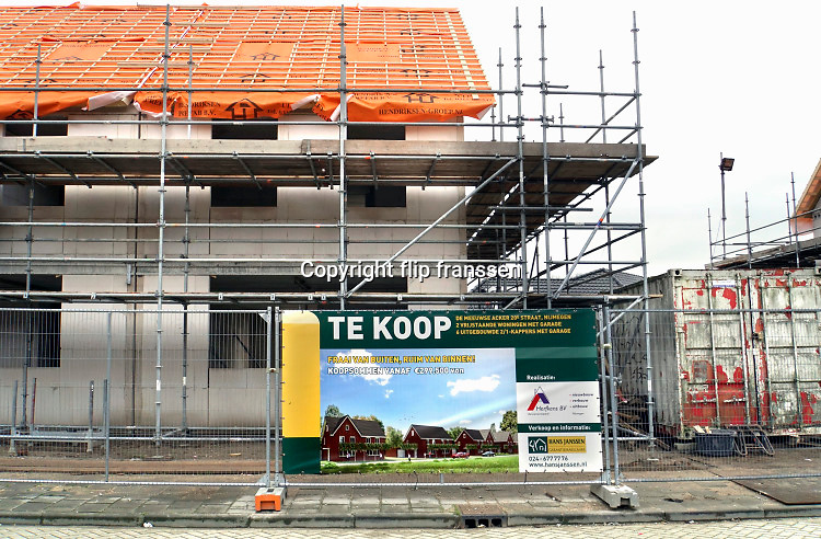 Nederland, Nijmegen, 8-1-2019Bouwvakkers werken aan een nieuwbouwproject. Timmerman . Foto: Flip Franssen