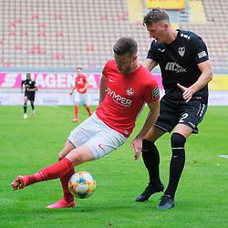 Fussball - 3.Bundesliga - Saison 2019/20<br /> Kaiserslautern -  Fritz-Walter-Stadion 20.6.2020<br /> 1. FC Kaiserslautern (fck) - KFC Uerdingen (uer) 4:0<br /> Christian KÜHLWETTER (1. FC Kaiserslautern), li - Edvinas GIRDVAINIA (ue)<br /> <br /> Foto © PIX-Sportfotos *** Foto ist honorarpflichtig! *** Auf Anfrage in hoeherer Qualitaet/Aufloesung. Belegexemplar erbeten. Veroeffentlichung ausschliesslich fuer journalistisch-publizistische Zwecke. For editorial use only. DFL regulations prohibit any use of photographs as image sequences and/or quasi-video.