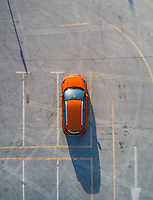 Aerial view of a car parked in an empty parking in Dubai, U.A.E.