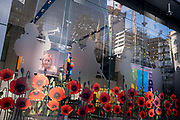 In advance of the nations Armistice Day on November 11th, to commemorate the sacrifice and service of woorld war victims and veterans, Red poppies appear on the exterior of insurance corporate Aviva , on behalf of the British Legions annual poppy appeal, at the comapnys Leadenhall headquarters in the City of London, the capitals financial district, on 21st October 2021, in London, England.