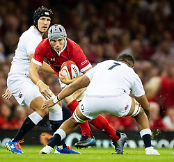 Jonathan Davies of Wales is tackled by Lewis Ludlam of England<br /> <br /> Photographer Simon King/Replay Images<br /> <br /> Friendly - Wales v England - Saturday 17th August 2019 - Principality Stadium - Cardiff<br /> <br /> World Copyright © Replay Images . All rights reserved. info@replayimages.co.uk - http://replayimages.co.uk
