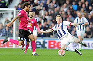 West Brom's JamesMcClean (r) challenges Peterborough's Lawrie Wilson. The Emirates FA Cup, 4th round match, West Bromwich Albion v Peterborough Utd at the Hawthorns stadium in West Bromwich, Midlands on Saturday 30th January 2016. pic by Carl Robertson, Andrew Orchard sports photography.