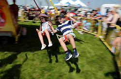 General view of kids enjoying the family entertainment during Kids Carnival Day of The Qatar Airways May Racing Carnival at Warwick Racecourse.
