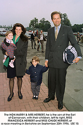 The HON.HARRY & MRS HERBERT, he is the son of the Earl of Carnarvon, with their children, left to right, MISS FRANCESCA HERBERT and MISS CHLOE HERBERT, at a race meeting in Berkshire on September 20th 1996.    LSE 15
