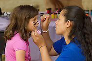 Middletown, New York - A girl gets her face painted at the Middletown YMCA Funzone during the Orange Regional Medical Center's Run 4 Downtown road race on Aug. 16, 2014.