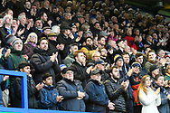 The fans pay tribute to John Jenkins with a minutes applause ahead of the EFL Sky Bet League 1 match between Portsmouth and Ipswich Town at Fratton Park, Portsmouth, England on 21 December 2019.