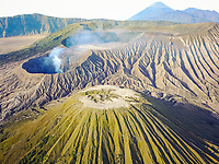 Aerial view of crater with smoke of the active volcano Bromo in Indonesia