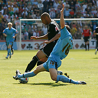 Photo: Steve Bond.<br />Coventry City v West Bromwich Albion. Coca Cola Championship. 28/04/2007. Diomansy Kamara (R) is tackled by David McNamee (R)