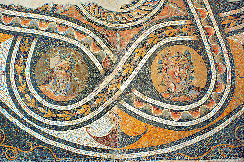 Floor mosaic with satyr heads and pan.  From a Roman villa which probably belonged to Marcus Aurelius and Lucius Verus. Genazzano. Circo 138-192 AD. National Roman Museum, Rome, Italy .<br /> <br /> If you prefer to buy from our ALAMY PHOTO LIBRARY  Collection visit : https://www.alamy.com/portfolio/paul-williams-funkystock/national-roman-museum-rome-mosaic.html <br /> <br /> Visit our ROMAN ART & HISTORIC SITES PHOTO COLLECTIONS for more photos to download or buy as wall art prints https://funkystock.photoshelter.com/gallery-collection/The-Romans-Art-Artefacts-Antiquities-Historic-Sites-Pictures-Images/C0000r2uLJJo9_s0