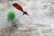 061210-Morrison, COLORADO-wildwaterart-Kayaker Bridger Steele, of Denver, emerges from the water after launching off a waterfall Saturday, June 12, 2010 on Bear Creek. Heavy rain fall at higher elevations has caused the normally peaceful creek to swell making conditions challenging for kayakers..Photo By Matthew Jonas/Evergreen Newspapers/Photo Editor