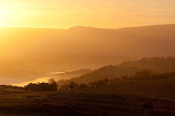 © Licensed to London News Pictures. 18/02/2016. Builth Wells, Powys, Wales, UK. View from The Mynydd Epynt towards the Brecons Beacons National Park at sunrise after a night with temoeratures dropping to - 3 degrees centigrade at 400 metres above sea level in Powys. Photo credit: Graham M. Lawrence/LNP
