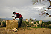 At a cemetery near Harare, Ethiopia, Nega Wondimu chips away at what will eventually become a headstone. Ethiopia is one of the countries more severely affected by HIV/AIDS and the number of people currently living with HIV/AIDS in Ethiopia is estimated to be 1.5 million. The HIV prevalence in rural areas is 2.3%, as opposed to a prevalence of 13.2% in urban areas.