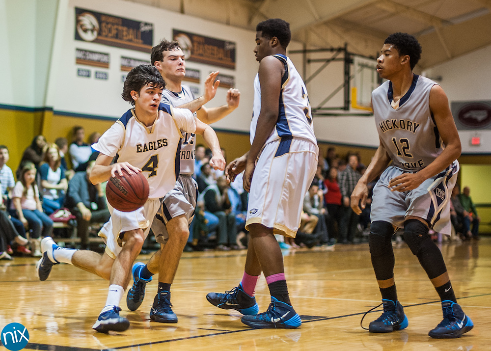 First Assembly's Bryan Murr drives to the basket against Hickory Grove Baptist Tuesday night. First Assembly won the game 81-47.