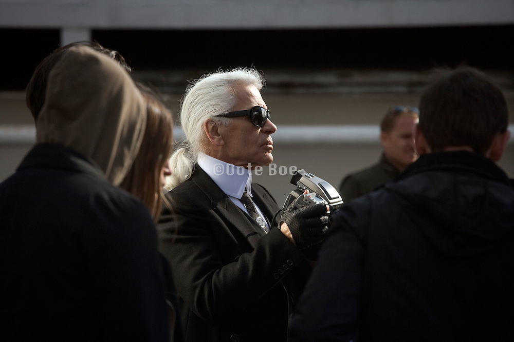 Karl Lagerfeld with crew during a shoot on Fulton Landing, Brooklyn, NY. March 24, 2008