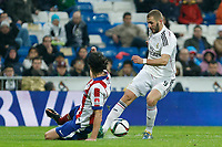 Real Madrid´s Karim Benzema (R) and Atletico de Madrid´s Tiago Cardoso during Spanish King´s Cup match at Santiago Bernabeu stadium in Madrid, Spain. January 15, 2015. (ALTERPHOTOS/Victor Blanco)