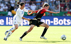 03.06.2011, Osnatel Arena, Osnabrueck, GER, WM 2012 FSP,  Deutschland (GER) vs Italien (ITA), .im Bild Kerstin Garefrekes (re./GER) vs Elisa Camporese (ITA) during the WM 2011 Friendly Game, Germany vs Italy, at Osnatel Arena, Osnabrück, 2011-06-03, .EXPA Pictures © 2011, PhotoCredit: EXPA/ nph/  Hessland       ****** out of GER / SWE / CRO  / BEL ******