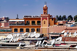 Jemaa el Fna - looking across satellite dish covered rooftops to the cafe Argana, Marrakech, Morocco, North Africa<br /> <br /> (c) Andrew Wilson | Edinburgh Elite media