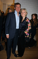 JO MALONE and her husband GARY WILLCOX at the opening party for Tom's Kitchen - the restaurant of Tom Aikens at 27 Cale Street, London SW3 on 1st November 2006.<br /><br />NON EXCLUSIVE - WORLD RIGHTS