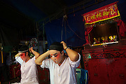 Teochew Opera Sing Tong, a travelling Chinese Opera troupe, prepare to perform in Thonburi.