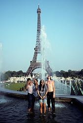 Eiffel Tower & Tourists Enjoying Thier Time In Paris