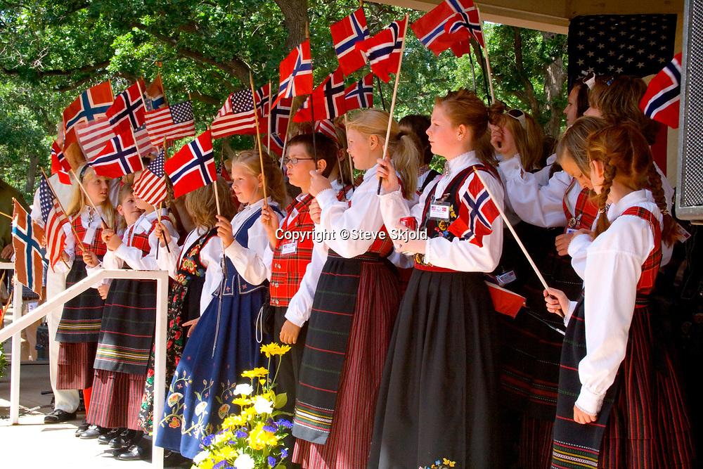 Children celebrating Norway Day waving Norwegian and American flags at Minnehaha Park. Minneapolis Minnesota MN USA