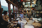 Grain and sundries shop in the Bhutanese capital of Thimphu. There are no western-style supermarkets in the country. This store is about as big as they come, and most all of the packaged goods come in overland from India. Bhutan. From Peter Menzel's Material World Project.