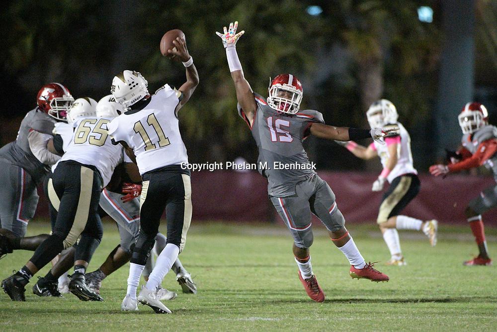 Edgewater's DJ Hampton (15) attempts to block a pass by Ocoee quarterback Myles Holder (11) during the second half of a high school football game Monday, Oct. 9, 2017, in Orlando, Fla. Edgewater won 44-29. (Photo by Phelan M. Ebenhack)