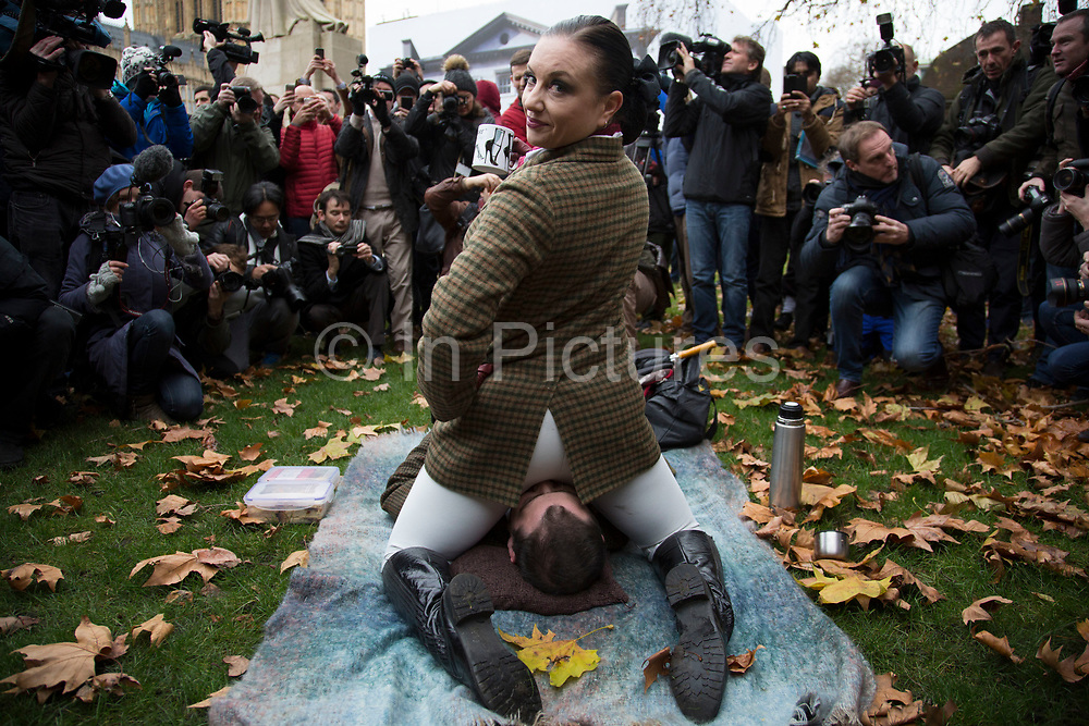 "London, UK. Friday 12th December 2014. Activists simulate sex acts in protest at new censorship laws. The organisers of the 'Sexual Freedom' demonstration claim British producers of online porn are being targeted by the new restrictions. This effectively bans the following acts from being depicted by British pornography producers: Spanking, caning, aggressive whipping, penetration by any object ""associated with violence"", physical or verbal abuse (regardless of if consensual), urolagnia (known as ""water sports""), role-playing as non-adults, physical restraint, humiliation, female ejaculation, strangulation, face-sitting, fisting. The final three listed fall under acts the BBFC views as potentially ""life-endangering"". While the measures won't stop people from watching whatever genre of porn they desire, as video shot abroad can still be viewed."