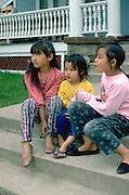 Hmong sisters ages 5 and 11 watching Cinco De Mayo Parade.  St Paul Minnesota USA
