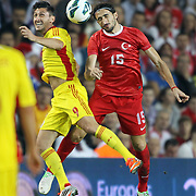 Turkey's Mehmet Topal (R) and Romania's Ciprian Andrei Marica (L) during their FIFA World Cup 2014 qualifying soccer match Turkey betwen Romania at Sukru Saracoglu stadium in Istanbul october 12, 2012. Photo by TURKPIX