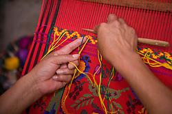 Central America, Guatemala, Antigua.  Hands weaving (close-up).