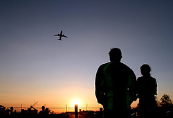 People watch a plane taking off in a park near the Juan Santamaria International Airport, in Alajuela city, 25km northwest of San Jose, capital of Costa Rica, on Feb. 28, 2015. EXPA Pictures © 2015, PhotoCredit: EXPA/ Photoshot/ [e]KENT GILBERT<br /> <br /> *****ATTENTION - for AUT, SLO, CRO, SRB, BIH, MAZ only*****