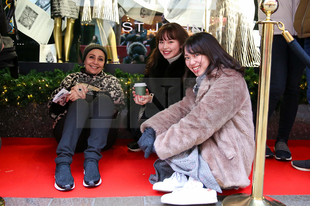 © Licensed to London News Pictures. 26/12/2018. London, UK. Shoppers queue outside the luxury department store Harrods in Knightsbridge ahead of the opening of the Boxing Day sale. Boxing Day is one of the busiest days for retail outlets with tens of thousands of shoppers taking advantage of the post-Christmas bargains. Photo credit: Dinendra Haria/LNP
