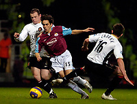 Photo: Ed Godden.<br /> West Ham United v Manchester United. The Barclays Premiership. 17/12/2006. West Ham's Yossi Benayoun is squashed between Wayne Rooney (L) and Michael Carrick.