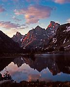 Lake Soliitude, Grand Teton National Park, Wyoming. Major peaks, L to R, Mt. Teewinot, Mt. Owen, Grand Teton. Cover of Boyd Norton's book, The Grand Tetons.