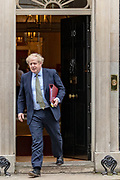 Bitain's Prime Minister Boris Johnson leaves 10 Downing Street in London, to attend the weekly session of PMQs, Wednesday, March 18, 2020. (Photo/Vudi Xhymshiti)