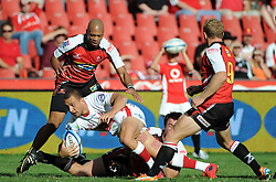 JOHANNESBURG, South Africa, 02 April 2011. Quade Cooper of the Reds tries to get away from Doppies la Grange (Capt) of the Lions with Lionel Mapoe and Jano Vermaak of the Lions in support during the Super15 Rugby match between the Lions and the Reds at Coca-Cola Park in Johannesburg, South Africa on 02 April 2011. .Photographer : Anton de Villiers / SPORTZPICS