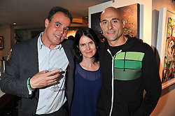 Left to right, JAKE ARNOTT, LIZA MARSHALL and MARK STRONG at a party to celebrate the publication on The House of Rumour by Jake Arnott held at The Ivy Club, West Street, London on 9th July 2012.
