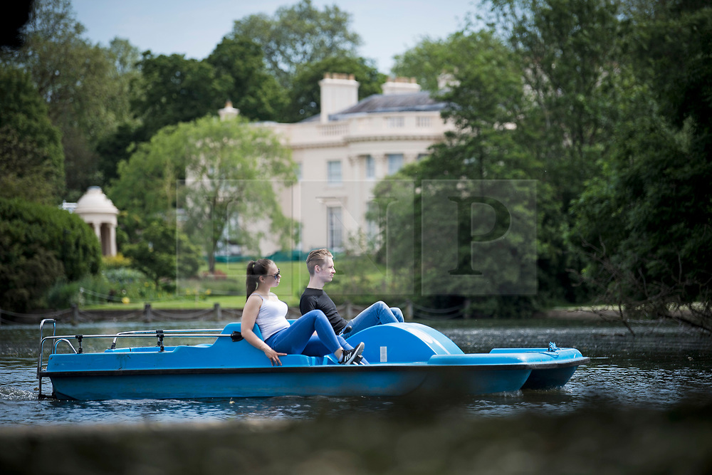 © Licensed to London News Pictures. 07/06/2021. London, UK. A couple use a paddle boat on the batting lake in Regents Park, central London on a warm summers morning. Photo credit: Ben Cawthra/LNP